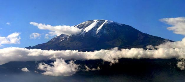 Rising up starkly above the plains, Mount Kilimanjaro is perhaps one of the worlds most recognised mountains