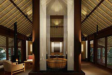 The rooms at the Malalika centre around a large teak bath
