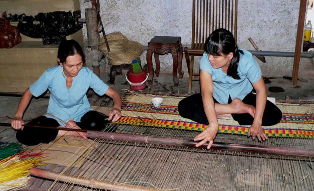 Silk Weavers plying their trade in Hoi An